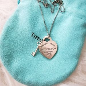 SOLD * TIFFANY HEART TAG WITH KEY PENDENT